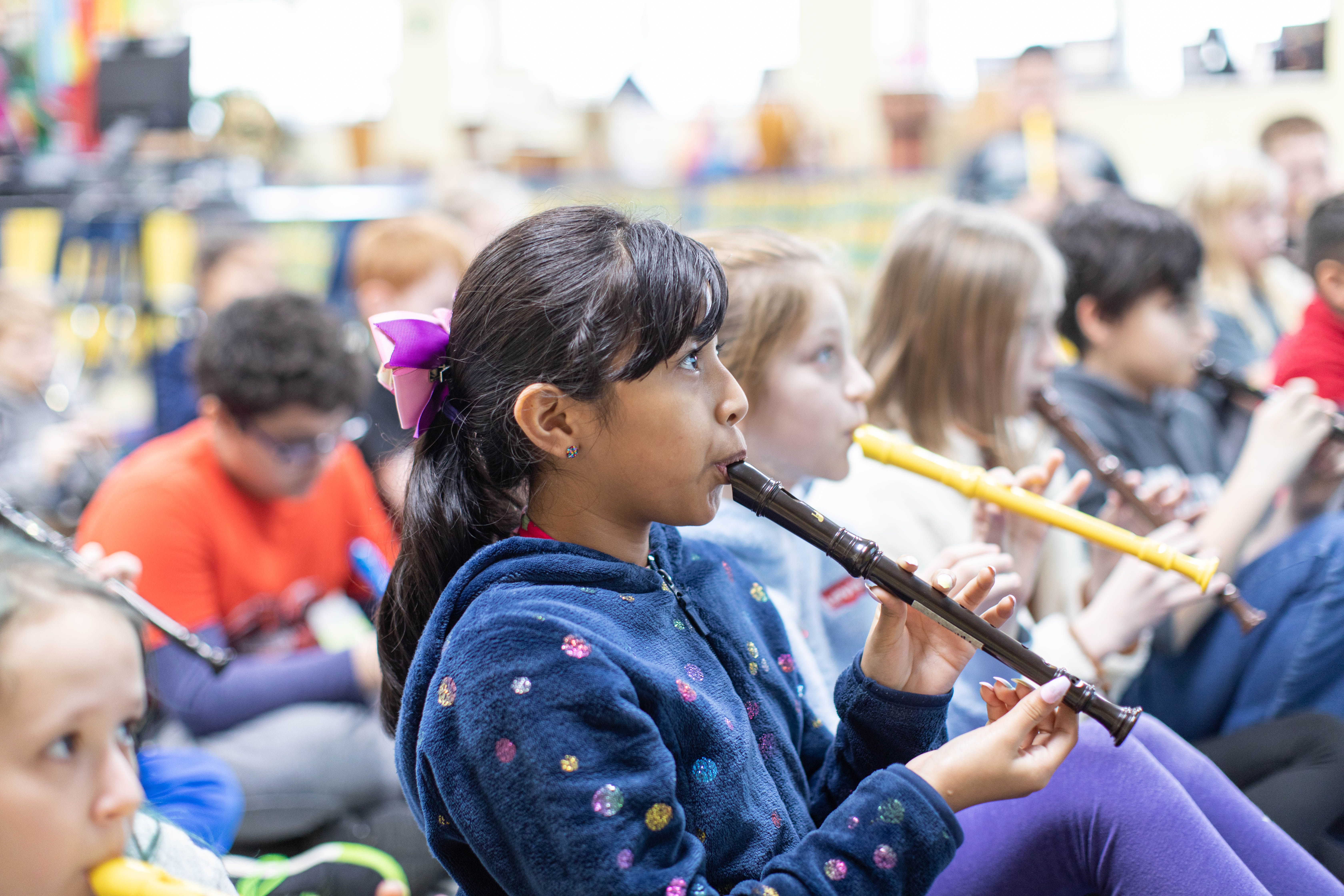 student playing recorder