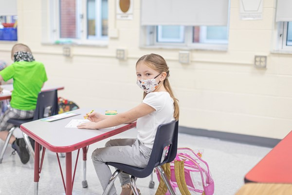 female student wearing a mask during class